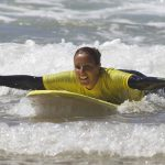 first steps of surfing with R Star surf school Carrapateira, the fun ride amado