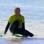 South of Portugal Algarve, surf school R Star stands up on the surfboard in they first lesson, Carrapateira