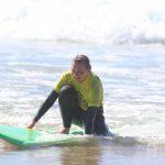 the ride of yellow rash vest R Star surf school amado beach Carrapateira