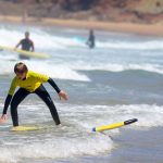Groms improving with turns at Amado beach Carrapateira surf school, R Star, qualify teaching, Algarve southwest of Portugal