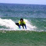 R Star surfer having a fun ride at Amado beach Carrapateira, Algarve southwest coast of Portugal