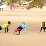 R Star yoga for the warm up with new star surfers Amado beach Carrapateira surf school, Algarve
