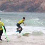 Riding waves and having lots of knowledge about and ocean, R Star surf school making competent surfers, Algarve south of Portugal