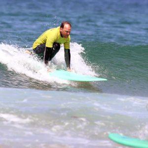 DROP INTERMEDIATE SURFER FROM R STAR SURF SCHOOL AT AMADO BEACH CARRAPATEIRA