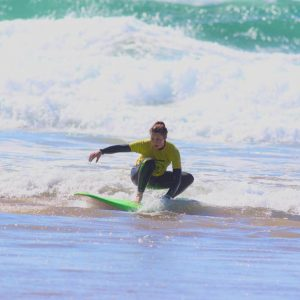 Amazing surf of the beginner on the broken waves of Amado beach at Carrapateira, Algarve, Portugal.