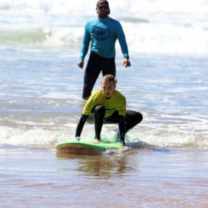 beginners surfing amado beach in Carrapateira, most beautiful village of Algarve, Portugal