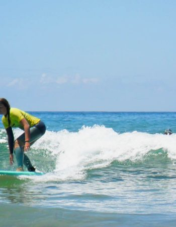 intermediate surfer girl from r star surf school amado beach carrapateira