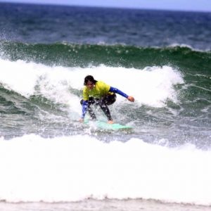 PREPERING THE BOTTOM TURN AT AMADO THE INTERMEDIATE SURFER FROM R STAR SURFSCHOOL