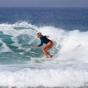 r star surfer riding waves indonesia